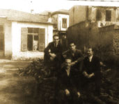 The factory yard, from left, top row: Odysseus (Yiapitzoglou's cousin), Helias Doundoulakis, and Nicos Oreopoulos; foreground, Nikitas.