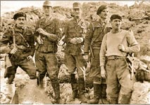Patrick Leigh Fermor, center, with kidnappers of General Kreipe in 1944, and Stanley Moss, second from left, both in German uniforms. Flanking them are George Tyrakis and Manolis Paterakis; Antonis Papaleonidas, far right.